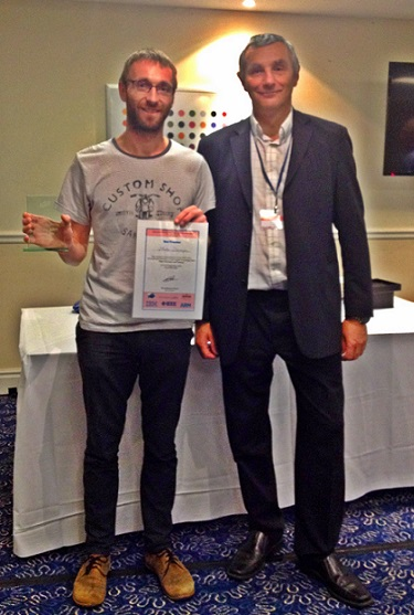 Teammember Martin Deinhofer received the 'Best Presenter Award' at the ITHET 2014 from Tony Ward